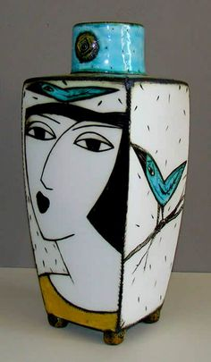 Charmaine-Haines female face and bird motif vase-South-Africa