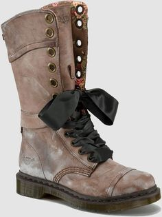 Dr Martens 1914 W Triumph 1914 W Brown MassaiDr Martens 1914 W Triumph 1914 W Brown Massai. Triumph Mid-Calf Boot. Raw-Edged Leather Uppers And Underlays. Tartan-Lined Collar And Buckle Strap. The Boots Can Be Worn Laced Up Tight Or Folded Down To Reveal The Tartan Lining. Signature Dr. Martens Welted Pvc Soles. Dr Martens Originals Triumph.  $160.00 Nice Docs for Womens Biker Boots