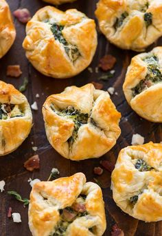 Spinach Puffs are an easy, DELICIOUS appetizer! Buttery squares of puff pastry, filled with cream cheese, spinach, feta, and bacon. Easy to make ahead!
