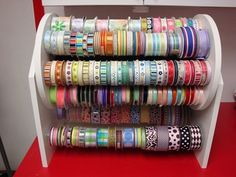This is by far the best ribbon organization nizer I've seen yet.I must have this in my craft room! It's pretty pricy, so it looks like I'll be saving my money for a while 'til I can buy it. Ribbon Organization, Ribbon Storage, Sewing Room Organization, Craft Room Storage, Organization Hacks, Craft Rooms, Organizing Tips, Storage Ideas, Tape Storage