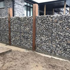 We're really happy with how this gabion fence turned out at our project. It was tedious work, but the result is ART! Well done boys fence 45 Stunning Fence Ideas Easy to Apply to Make Sure your House Safe Diy Fence, Backyard Fences, Garden Fencing, Backyard Landscaping, Gabion Fence Ideas, Fence Design, Garden Design, Modern Wood Fence, Gabion Retaining Wall