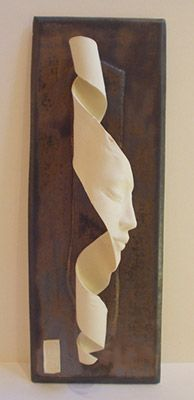 Wall Piece | Face on Ribbon in Porcelain by Lucinda Brown