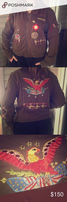 "Double D Ranch Jacket with Patches, Pins & Studs Double D Ranch are the leaders in unique boho wearables that you cannot find elsewhere. This incredibly one-of-a-kind discontinued jacket is super soft dark chocolate color with hand embroidered stitches, patches, studs, & pins. On the back is a hand sewn rhinestone eagle with the quote ""Play Nice, Be Free.""  There are so many gorgeous details like tweed plaid elbow patches, USA pins, an assortment of colorful hand stitches made to dangle…"