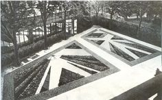 Gabriel Guvrekian's revolutionary 1920s parterre garden for Marie Laure and Charles de Noailles at Hôtel Bischoffsheim in Paris. The radiant arrangements of plants and gravel resemble great sheets of shattered glass. A wall of mirror doubles the glory.