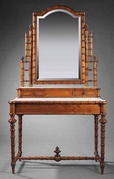 An Aesthetic Maple Faux Bamboo Dressing Table, late 19th c., the arched mirror flanked by stepped stiles on stepped case with two drawers, the inset white marble top on a conforming frieze, the trumpet turned legs joined by a stretcher.