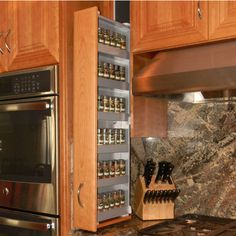 DCF-8001 Spice Rack Storage System, Right or Left Facing in Silver with Simple Down and Forward Motion by Dropout Cabinet Fixtures | KitchenSource.com