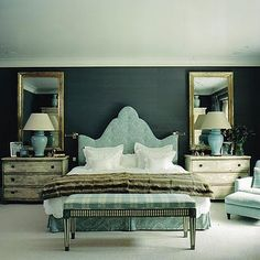 ROOST - small dressers as nightstands, tall mirrors behind bedside lamps