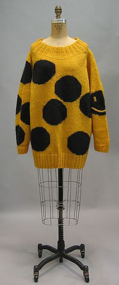 If there's one style from the 80s I incorporate in my style of dress most often its chunky sweaters. Women and men began to wear big, oversized sweaters during the 80s. Often the sweaters, like the one pictured here, would have fun designs, funky knits, or even a pop culture reference.