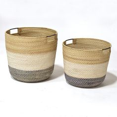 These nesting baskets feature contrasting black, white and natural rattan in a coil weave design. Accented with hand-stitched nito vine details and metal handles, these baskets are proof that details are everything! Colors may vary. Rattan Basket, Wicker, Large Baskets, Woven Baskets, Nautical Home, Nautical Bedroom, D 20, Storage Baskets, Extra Storage