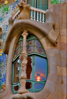 "Gaudi's Casa Batllo in Barcelona, Spain. The enlarged windows on the first floor give it the nickname, ""House of Yawns."""