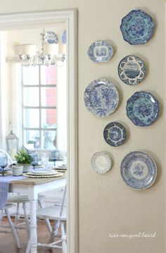 I thought I'd pull out some of my favorite blue and white plates and create a little asymmetrical display on an empty wall. There are a few other little vignettes I'll share later in the week.
