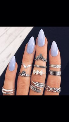 This color of nail polish and boho rings are needed