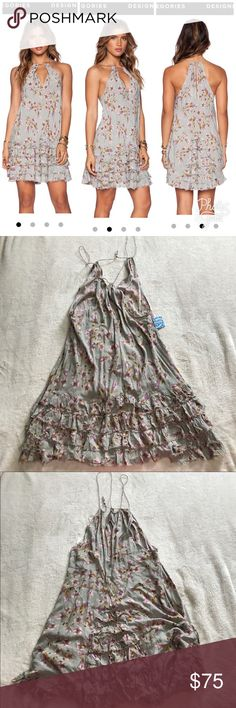 """free People ruffle feather seafo dress sz large New with tags intimately free People ruffle feather dresses in seafoam. Beautiful floral print, flowy cool fabric, perfect for summer! Size large. Flat measurements: chest- 22"""", waist- 21"""", length from pit- 25"""" Free People Dresses"""