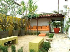Courtyard Calm:     Stone and gravel create flexible and functional surfaces in this small urban space, with large pots, architectural foliage plants and brightly colored seat cushions providing the main drama.