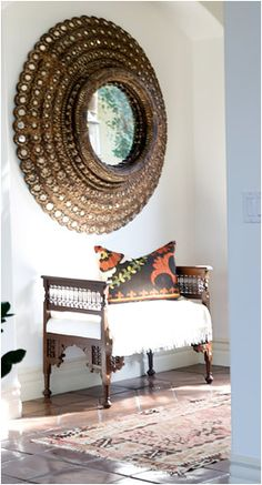 Hallway Seating Area with Carved Wood Bench,  Peacock Mirror, mixed patterns in pillow and rug