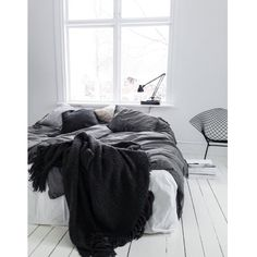 We love a messy bed styling. The contrasts here are amazing. Get this look with our Relaxed Denim Graphite Bed linen http://www.secretlinenstore.com/relaxed-denim-graphite-grey-cotton-bedding-set. Messy bed | Photo ©bycazandra