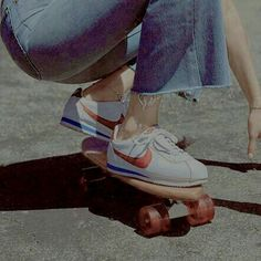 ad497b54daf vintage skateboard penny board Nike sneakers and cut off jeans