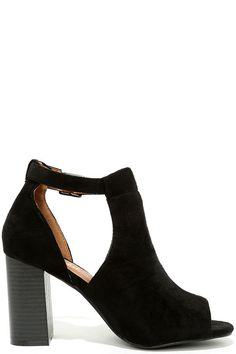 """Give your outfit a little extra """"oomph"""" with the Sharri Black Suede Peep-Toe Booties! A vegan suede, peep-toe upper has a cool, cutout collar with a gunmetal buckle strap."""