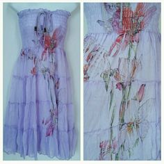 """Lovely in Lavender dress"" NWT Brand new with tags Lovely and lavender tube top dress ties at neckline. Beautiful floral print down the front.   Material is 100% polyester  length of approximately 33 inches.  Bust area is stretchy Dresses"
