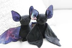 Flying to you straight from outer space, this galaxy bat stuffed animal is part science fiction and part snuggles. Each plush is made with soft minky and silky, custom printed galaxy fabric. Bring hom