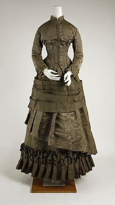 dark brownish green Dress, very layered skirt with fitted bodice; 1882, American; metmuseum.org
