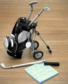 This Tiny Golf Bag with Writing Clubs is Perfect for the Office #fathersday trendhunter.com