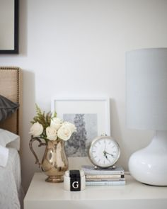Guest room 101: fresh flowers, an alarm clock, books & lighting