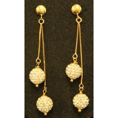 Earrings in 18 kt gold with cubic zirconia pendants and