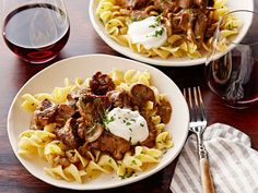 Beef Stroganoff over Buttered Noodles : Fragrant with cognac and fresh thyme, a bowl of this hearty Russian beef dish is best served over tender egg noodles, which soak up the meaty broth.