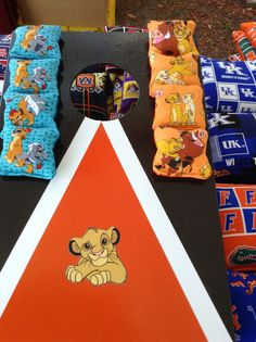 Brand new, made to order Lion Ling Cornhole set (also known as beantoss) Price includes the below:  2 x boards (450mm x 300mm) with characters of your choice, 8 bags (patterned bags as in the photo) Rules Scoresheet  Aim of the game is to throw bags towards the boards and score points by shooting through the hole or landing bags on the boards  Great for kids parties, or as entertainment indoors and outdoors for the summer! We do have much more choices available on our Facebook page M&C…