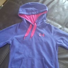 Women's Under Armour Sweatshirt This is a purple and pink sweatshirt, it is a junior size x-small Under Armour Tops Sweatshirts & Hoodies