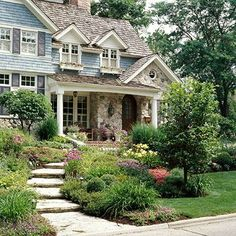front yard ideas - plant all the way out front. This blue home is beautiful.  this looks nice.