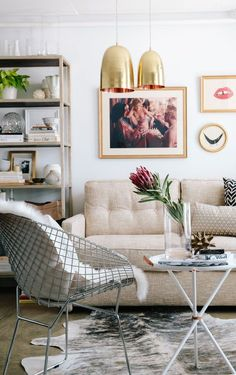 Neutral toned apartment interior with copper accents and pops of pink.