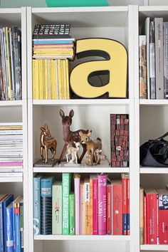 "Sneak Peek: Verena Michelitsch. ""I think I started to collect deer (Bambis) around age 20, actually influenced by the street artist Miss Van, who has a lot of deer in her paintings. The collection grew as people began gifting me Bambi figures. I used to intern at Pentagram, that´s where I saw a huge bookshelf with books arranged by color in their conference room. My collection of books was not that big but I still like the idea of it."" #sneakpeek"