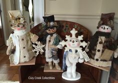 Handmade Primitive Snowman dolls, from left to right, Mr New Year 2016,  By Lantern Light Snowman, Snowflake Kisses Snowman, Woodland Snowman
