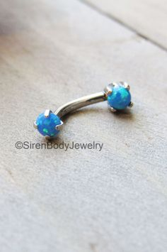 Gorgeous opals! Pin for later. Rook piercing jewelry 16g blue opal daith earring barbell titanium vertical labret body piercing ring anti eyebrow stud 16g curved bar rings $29.99  SirenBodyJewelry.etsy.com