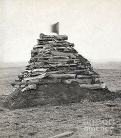 LITTLE BIGHORN MONUMENT. Monument on Custer's Hill, containing all the bones found at the site of the Battle of Little Bighorn. Photograph by Stanley Morrow, c1876.
