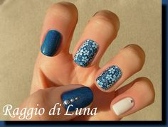 Nailpolis Museum of Nail Art | White flowers on blue skittlette by Tanja