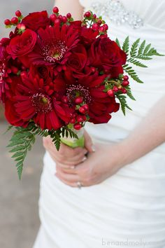 Winery wedding, vineyard wedding. Bridal bouquet. Bouquet ideas. Wedding bouquet. Red roses, Gerbera daisies, hypericum berries, leather fern.