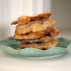 """These golden, crispy-sweet, tortilla-like fritters are sprinkled with cinnamon and sugar or topped with syrup. What is the difference between Buñuelos and Sopaipillas? My grandma made these crispy treats but never called them """"buñuelos"""". Mexican Bread, Mexican Dishes, Mexican Food Recipes, Snack Recipes, Dessert Recipes, Mexican Desserts, Tamales, Mexican Bunuelos Recipe, Recipes With Flour Tortillas"""