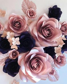 """Luxury paper flowers set for wall decorations. This set includes: - 2 paper flowers of 15"""" diameter - 3 paper flowers of 10"""" diameter - 6 paper flowers of 7"""" diameter - 4 paper flowers of 5"""" diameter - 4 groups of 3 hydrangea flowers - 5 leaves Custom orders are welcome."""