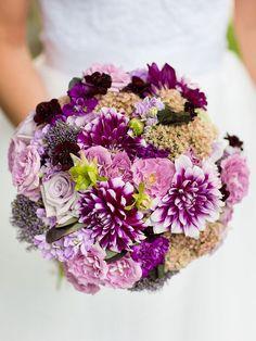Purple wedding bouquet with dahlias, sedum, roses and double stock