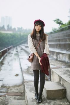 Gyaru, elegant: Dark red beret. Off white shirt. Gray dress with pattern. Dark gray stockings. Black, leather shoes. Dark red cardigan. Brown bag.