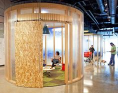 AOL Offices by Studio O+AOL's office features an open-plan layout with exposed ceilings, concrete floors and meeting areas built from oriented strand board.