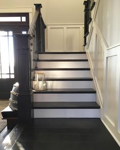 Modern farmhouse painted and stained stairs with brass lantern | Farmhouse Redefined (@farmhouseredefined) on Instagram