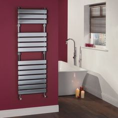 Add designer style to your bathroom with this flat panel hydronic towel warmer