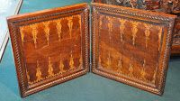 15th century Italian game box made of walnut. The outside of the box has a chess board and a nine men's morris board. The inside is a backgammon board. Auction images from internet. Image 5 of 5