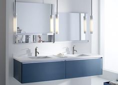 Love the sleek lines and ultra modern style, plus the mirrors that lift up! Master bath (dream).