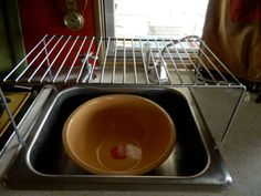Girl Camping: Simple Ideas for More Storage, Less Clutter. She uses a bowl instead of the sink. Easier to clean.