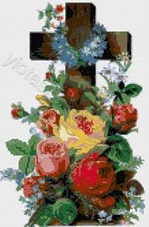 A religious design of a cross with roses in cross stitch kit or pattern.